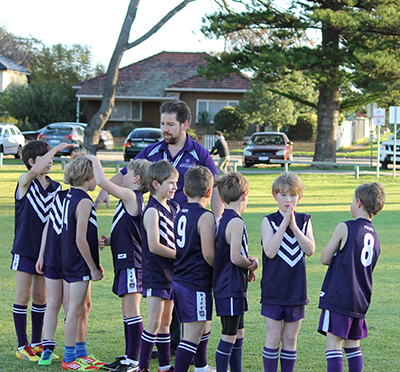 Ben coaches the kids at his son's club, the Fremantle City Dockers Junior Football Club.