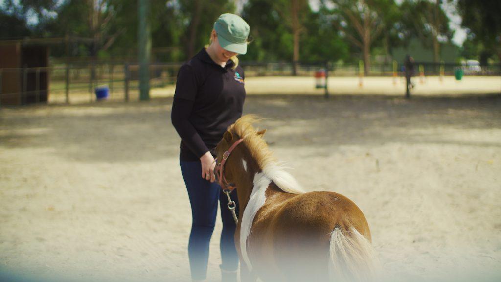 Shelly handling a horse at HorsePower